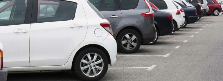 Who Do You Sue if Someone Backs into Your Car in a Mall Parking Lot?
