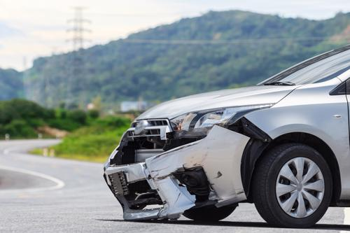 Damaged car in road after accident
